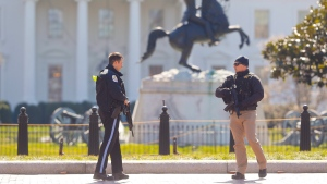 Law enforcement officers at Lafayette Park across from the White House in Washington, close the area to pedestrian traffic, Saturday, March 3, 2018. (AP Photo/Pablo Martinez Monsivais)