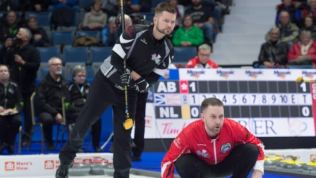 Manitoba's Carruthers edged Saskatchewan's Laycock 7-5 in extra end at Brier
