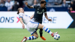 Montreal Impact's Samuel Piette, left, tackles Vancouver Whitecaps' Yordy Reyna during the second half of an MLS soccer game in Vancouver, B.C., on Sunday March 4, 2018. THE CANADIAN PRESS/Darryl Dyck