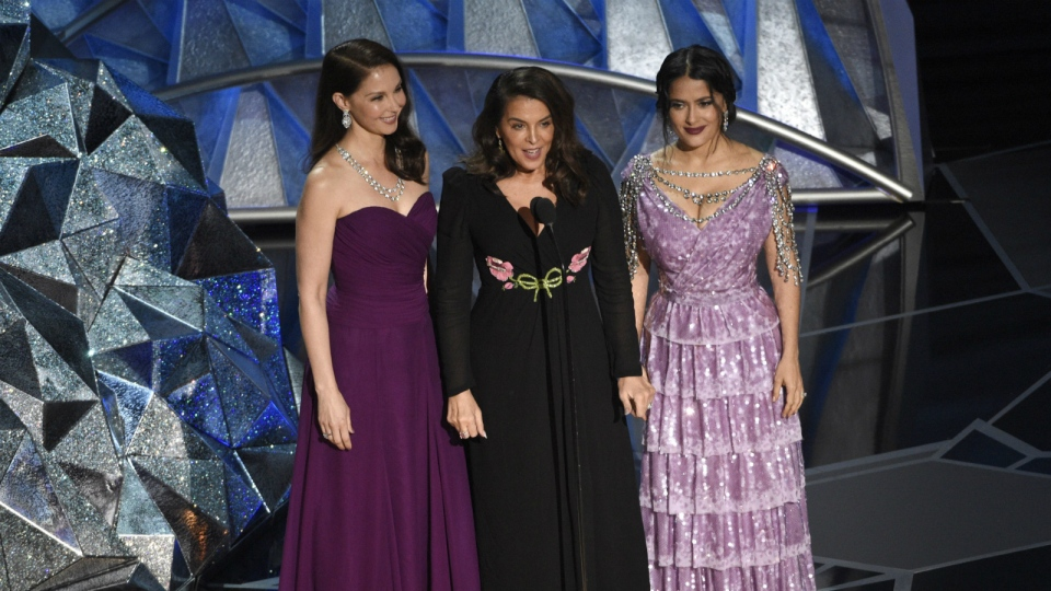 Ashley Judd, from left, Annabella Sciorra and Salma Hayek speak at the Oscars at the Dolby Theatre in Los Angeles on Sunday, March 4, 2018. (Chris Pizzello/Invision)
