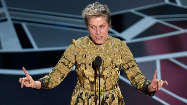 "Frances McDormand accepts the award for best performance by an actress in a leading role for ""Three Billboards Outside Ebbing, Missouri"" at the Oscars on Sunday, March 4, 2018, at the Dolby Theatre in Los Angeles. (Photo by Chris Pizzello/Invision/AP)"