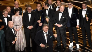 Guillermo del Toro and the cast and crew of 'The Shape of Water' accept the award for best picture at the Oscars on Sunday, March 4, 2018, at the Dolby Theatre in Los Angeles. (Photo by Chris Pizzello/Invision/AP)