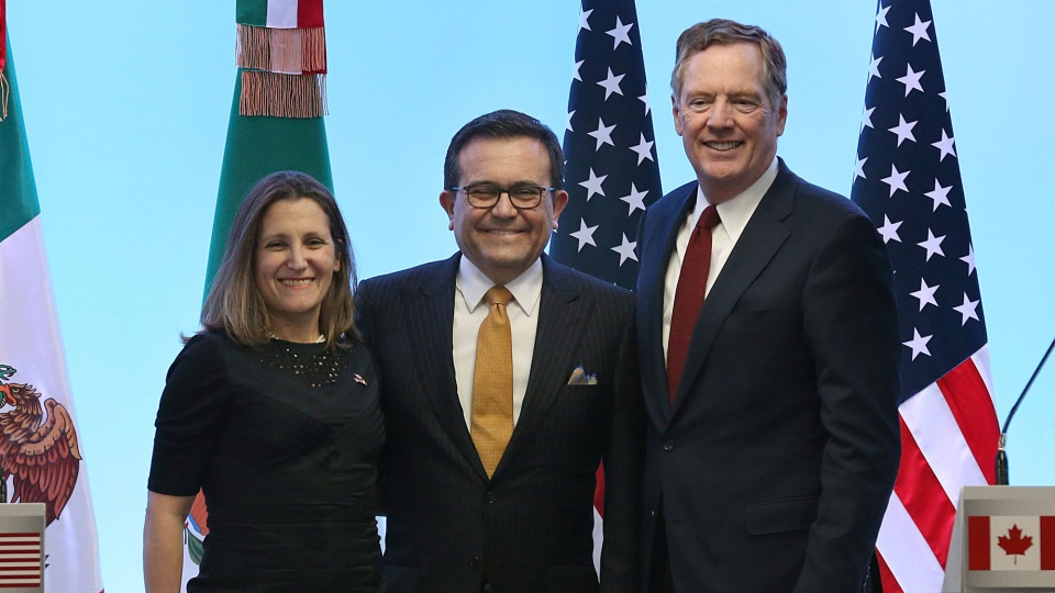 Mexico's Secretary of Economy Ildefonso Guajardo Villarreal,from left, Canadian Foreign Affairs Minister Chrystia Freeland, and U.S. Trade Representative Robert Lighthizer, pose for a group photo at a press conference regarding the seventh round of NAFTA renegotiations in Mexico City, Monday, March 5, 2018. (AP / Marco Ugarte)