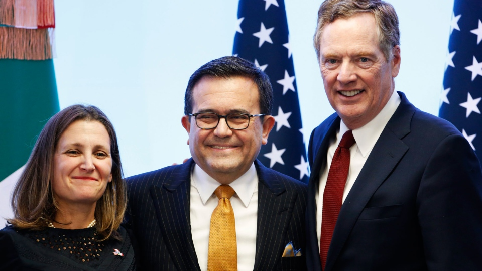 In this file photo from Monday, March 5, 2018, Canadian Foreign Affairs Minister Chrystia Freeland, left, Mexico's Secretary of Economy Ildefonso Guajardo Villarreal, center, and U.S. Trade Representative Robert Lighthizer pose for a photo at a press conference regarding the seventh round of NAFTA renegotiations in Mexico City. (AP Photo/Marco Ugarte)