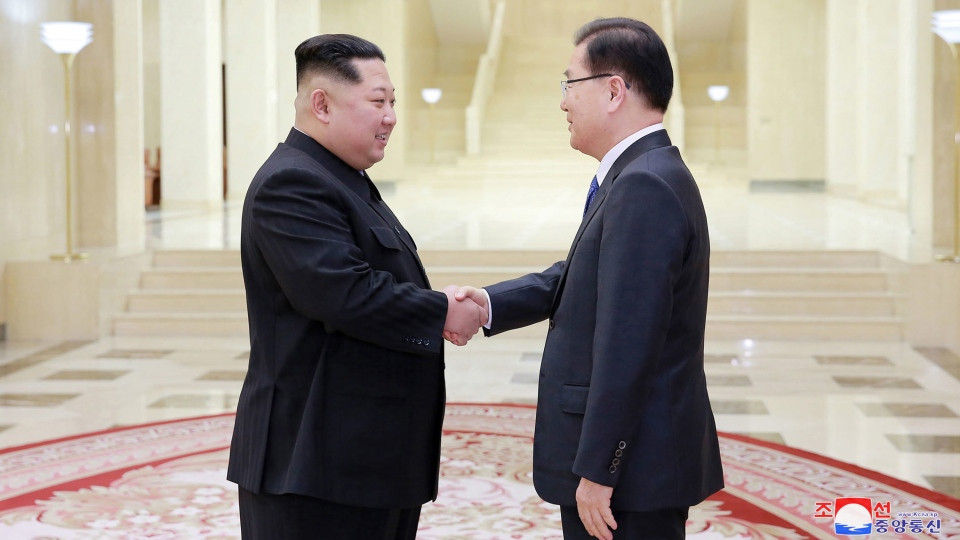 In this Monday, March 5, 2018 photo, provided by the North Korean government on March 6, North Korean leader Kim Jong Un, left, shakes hands with South Korean National Security Director Chung Eui-yong in Pyongyang, North Korea. (Korean Central News Agency/Korea News Service via AP)