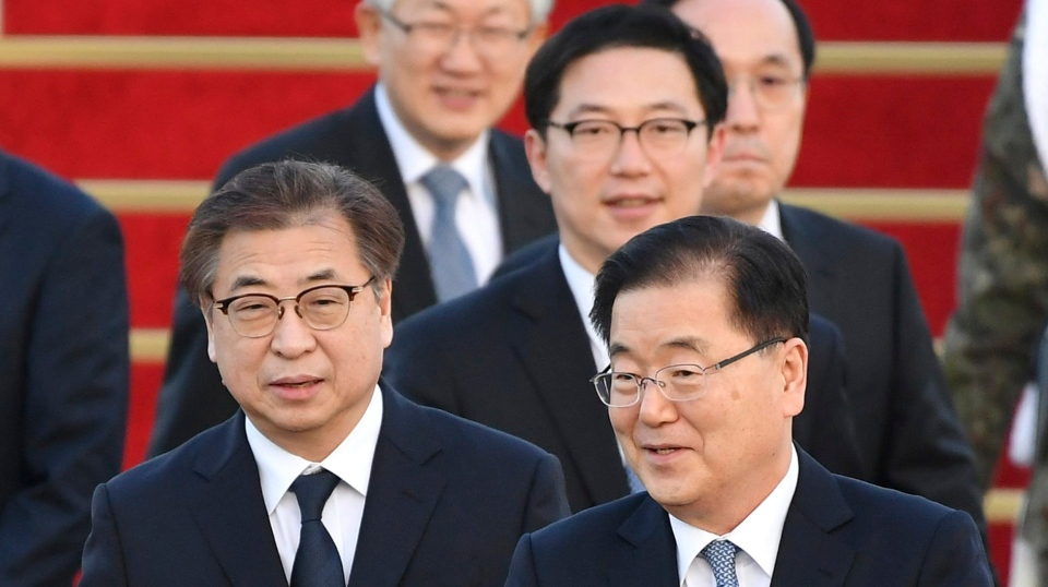 South Korean National Security Director Chung Eui-yong, right, and National Intelligence Service Chief Suh Hoon, left, with other delegates arrive at a military airport in Seongnam, south of Seoul, South Korea, Tuesday, March 6, 2018. (Song Kyung-seok/Pool Photo via AP)