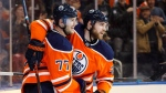 Edmonton Oilers' Oscar Klefbom (77) and Leon Draisaitl (29) celebrate a goal against the Arizona Coyotes during overtime NHL action in Edmonton, Alta., on Monday March 5, 2018. THE CANADIAN PRESS/Jason Franson