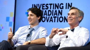 Prime Minister Justin Trudeau gives a thumbs up as he participates in an an armchair discussion with Bill Nye, right, highlighting Budget 2018's investments in Canadian innovation at the University of Ottawa in Ottawa on Tuesday, March 6, 2018. THE CANADIAN PRESS/Justin Tang