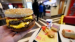 A McDonald's Double Quarter Pounder is shown with the new fresh beef Tuesday, March 6, 2018, in Atlanta. (AP Photo/Mike Stewart)