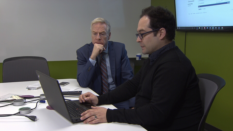 Janos Sitar shows Ross McLaughlin the technology Central 1 Credit Union is using to make its website more accessible. (CTV)