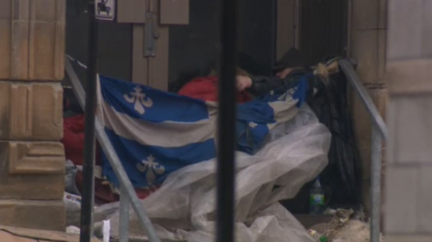 A person sleeps outdoors in Montreal