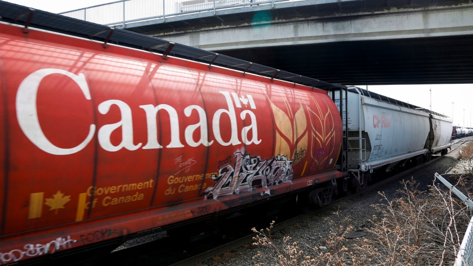 A Canadian Pacific Rail train hauling grain passes through Calgary, Thursday, May 1, 2014. (Jeff McIntosh/THE CANADIAN PRESS)