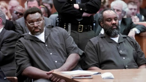Nathaniel and Anthony Cook sit during their sentencing at Lucas County Courthouse in Toledo, Ohio on April 6, 2000. (Lori King/The Blade via AP)