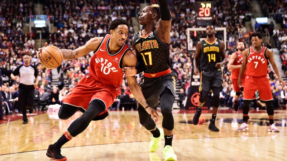Toronto Raptors guard DeMar DeRozan (10) drives past Atlanta Hawks guard Dennis Schroder (17) during second half NBA basketball action in Toronto on Tuesday, March 6, 2018. (THE CANADIAN PRESS/Frank Gunn)