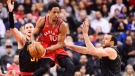 Toronto Raptors guard DeMar DeRozan (10) looks to pass as Atlanta Hawks forward Mike Muscala, left, and Hawks centre Miles Plumlee, right, defend during first half NBA basketball action in Toronto on Tuesday, March 6, 2018. THE CANADIAN PRESS/Frank Gunn