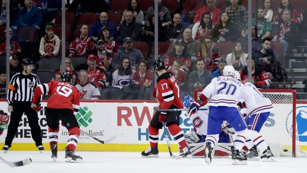 A shot by New Jersey Devils center Travis Zajac (19) enters the net of   DALLAS a2191a944