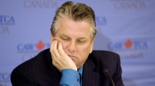 Ken Lewenza, president of the Canadian Auto Workers union, listens to a question during a press conference, in Toronto, on Friday, May 22, 2009. (Chris Young / THE CANADIAN PRESS)