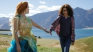 """This image released by Disney shows Reese Witherspoon, left, and Storm Reid in a scene from """"A Wrinkle In Time."""" (Atsushi Nishijima/Disney via AP)"""