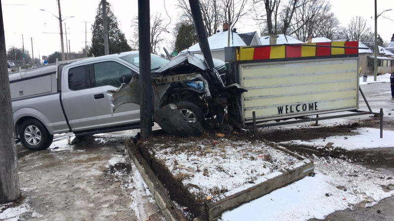 Stolen truck crashes into a sign on Wharncliffe Rd. in London Ont. on March 7, 2018. (Jim Knight)