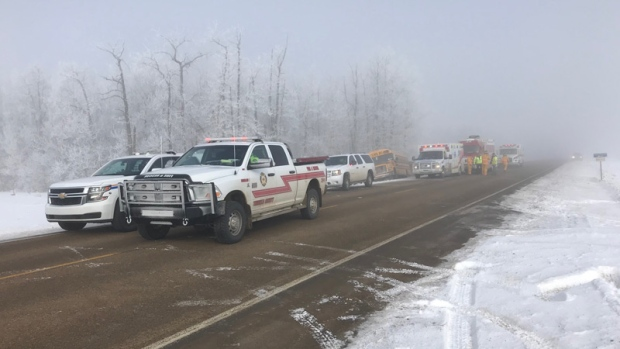 Teenage girl dead after Alberta collision between semi truck and school bus
