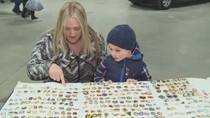Weston Urmel and his mother, Sheena, look at pins at the Brier on March 7, 2018