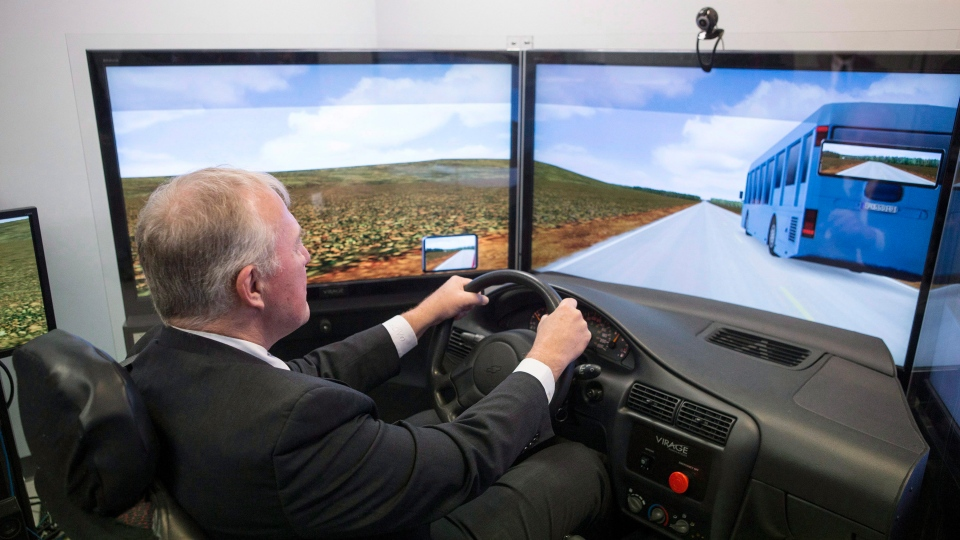 Bill Blair, Parliamentary Secretary to the Minister of Health, sits in a driving simulator meant to simulate the effects of driving under the influence of cannabis, during a photo opportunity at Centre for Addiction and Mental Health (CAMH) in Toronto on Wednesday January 24, 2018. THE CANADIAN PRESS/Chris Young