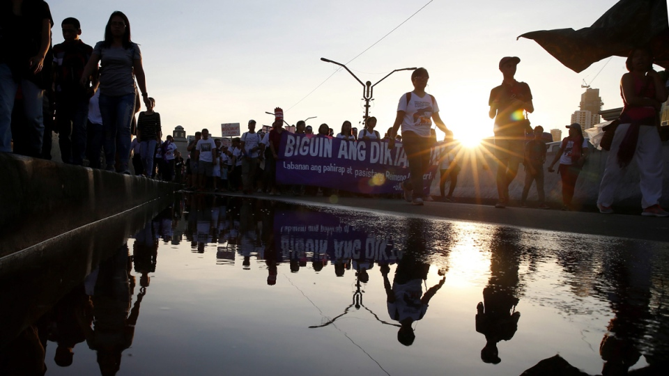 Protesters march towards the Presidential Palace in Manila, Philippines, to mark International Women's Day, on March 8, 2018. (Bullit Marquez / AP)