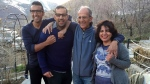 This undated photo provided by the family of the late Iranian-Canadian professor Kavous Seyed-Emami, shows him, second right, and his wife, Maryam Mombeini, right, and their two sons in an unidentified place in Iran. (Family of Kavous Seyed-Emami via AP)