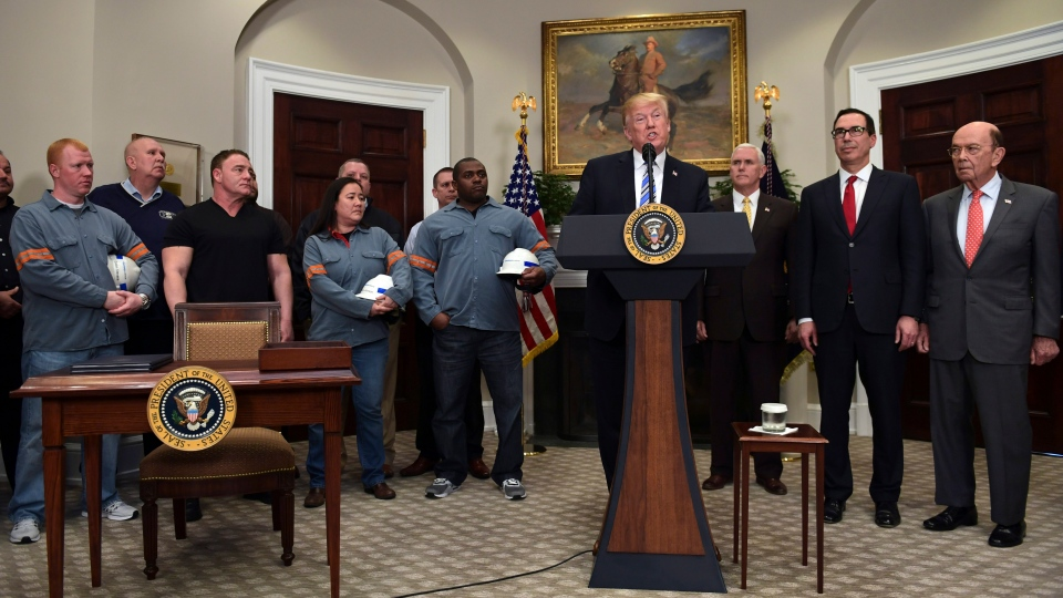 U.S. President Donald Trump, center, speaks in the Roosevelt Room of the White House in Washington, Thursday, March 8, 2018, before signing two proclamations, one on steel imports and the other on aluminum imports. (AP Photo/Susan Walsh)