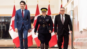 "Brenda Lucki, center, Prime Minister Justin Trudeau, left, and Ralph Goodale, minister of public safety and emergency preparedness enter a press event at RCMP ""Depot"" Division in Regina, Saskatchewan on Friday March 9, 2018. Lucki, who was Depot's commanding officer, was appointed Canada's first permanent female RCMP commissioner. THE CANADIAN PRESS/Michael Bell"