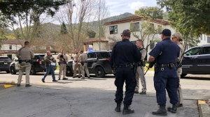 Law enforcement members stage at the Veterans Home of California after reports of an active shooter Friday, March 9, 2018, in Yountville, Calif. N(JL Sousa/Napa Valley Register via AP)
