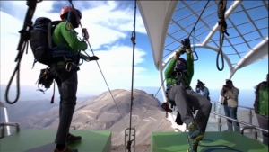Two men get ready to zipline through the desert in the United Arab Emirates.