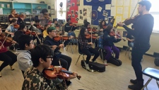 Fiddler Karrnnel Sawitsky at St. Michael school