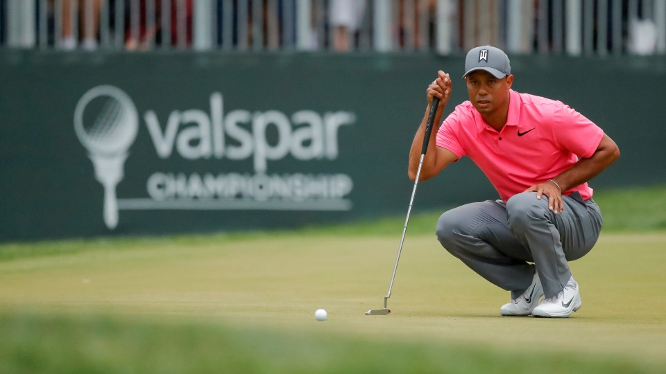 464a9dffcd5e3 Tiger Woods lines up a putt on the 16th hole during the third round of the Valspar  Championship golf tournament Saturday