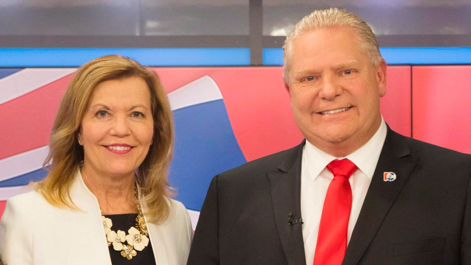 In this file photo, Ontario Conservative party leadership candidates Christine Elliott and Doug Ford apose for a photo in Toronto on Thursday, February 15, 2018 following a televised debate. THE CANADIAN PRESS/Chris Young