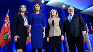 Ontario PC leadership candidates Tanya Granic Allen, Caroline Mulroney, Christine Elliott and Doug Ford pose for a photo after participating in a debate in Ottawa on Wednesday, Feb. 28, 2018. (THE CANADIAN PRESS/Justin Tang)