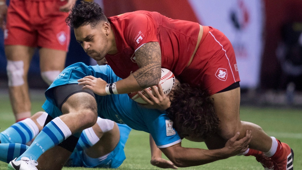 Mike Fuailefau of Canada tries to get past Diego Ardao of Uruguay during the World Rugby Seven Series at B.C. Place in Vancouver, Saturday, March, 10, 2018. (Jonathan Hayward/THE CANADIAN PRESS)