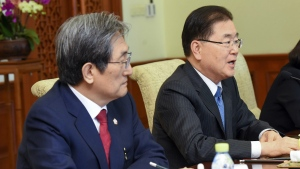 South Korea's National Security Director Chung Eui-yong, right, and South Korean ambassador to China Noh Young-min meet with Chinese State Councilor Yang Jiechi at the Diaoyutai State Guesthouse in Beijing Monday, March 12, 2018. (Etienne Oliveau/Pool Photo via AP)