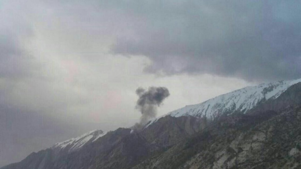 A Turkish private charter aircraft bound from Sharjah, U.A.E., to Istanbul crashed in the mountains of west Iran, killing at least 11 people on Sunday, March 11, 2018.  (Credit: Iranian Red Crescent Society)