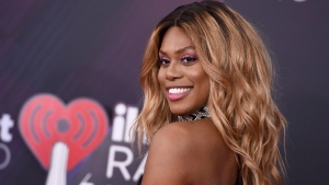 In this file photo, Laverne Cox arrives at the iHeartRadio Music Awards at The Forum on Sunday, March 11, 2018, in Inglewood, Calif. (Photo by Jordan Strauss/Invision/AP)
