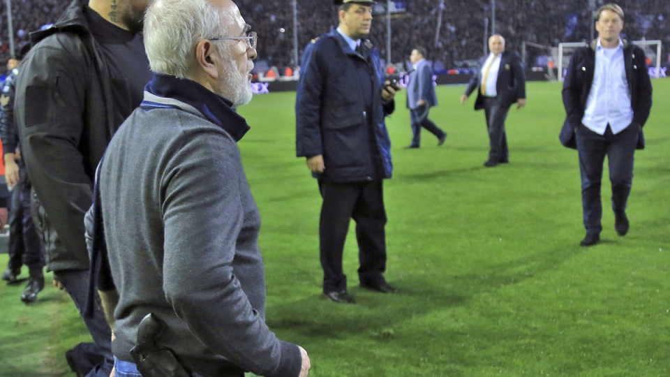 PAOK owner Ivan Savvidis on the pitch during the Greek League soccer match between PAOK and AEK Athens on March 11, 2018. (InTime Sports via AP)