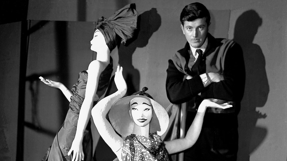 Hubert de Givenchy poses with mannequins in his shop in Paris, on Feb.1 1952. (AP)