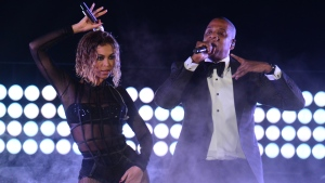 A photo taken on January 26, 2014 shows Beyonce Knowles and Jay-Z performing on stage for the 56th Grammy Awards at the Staples Center in Los Angeles, California. (© AFP PHOTO / Frederic J. BROWN)