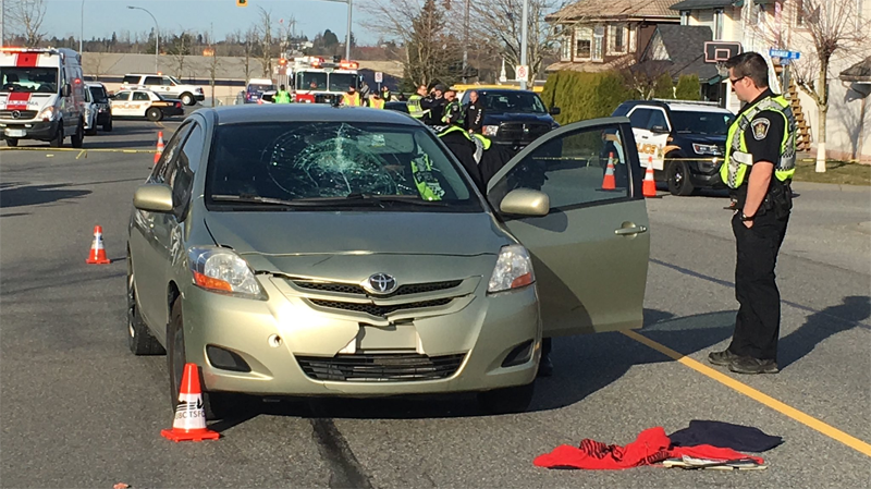 Police, paramedics and firefighters respond to an accident on Ridgeview Drive in Abbotsford, B.C.