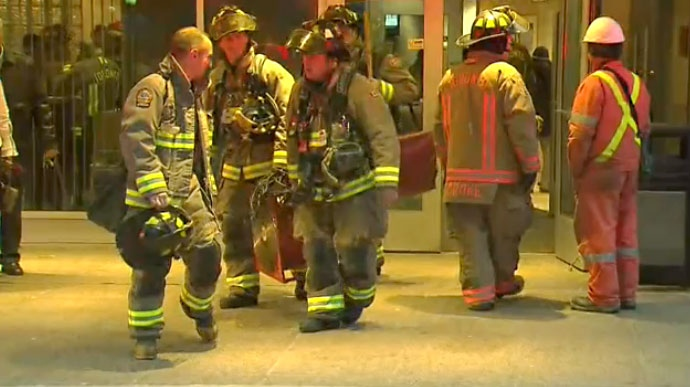Firefighters leave a North York building after knocking down a fire on the 20th floor on March 12, 2018. Two people were sent to hospital with critical injuries as a result.