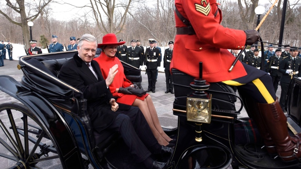 King Philippe of Belgium waves as he and Queen Mathilde arrive at Rideau Hall by Landau carriage during a state visit in Ottawa on Monday, March 12, 2018. THE CANADIAN PRESS/Justin Tang