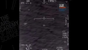 This image from video shows an unknown white object, centre, recorded through an infrared camera mounted on a U.S. Navy jet in 2015. The video was declassified by the U.S. Department of Defense and released to the research Group To The Stars on March 12, 2018.