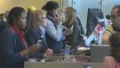 Air Canada agents work to get travellers on their way at the Calgary airport after a system-wide outage.
