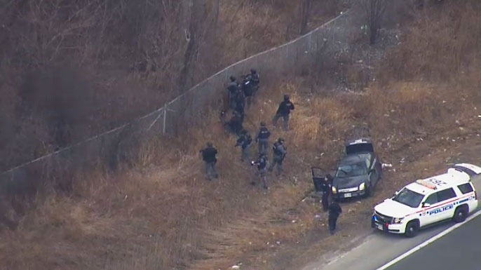 Police officers off Highway 401 in Ajax search for multiple suspects that fled from a bank robbery in Durham Region.