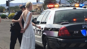 This photo provided by the Marana Police Department, in Arizona, shows 32-year-old Amber Young during her arrest on suspicion of impaired driving, Monday, March 12, 2018, in southern Arizona. (Marana Police Department via AP)